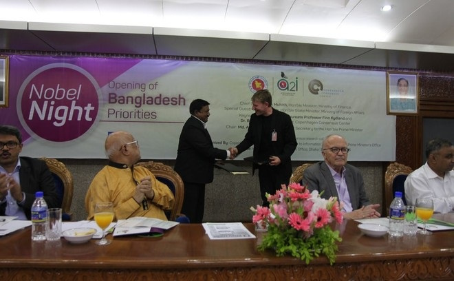 MoU signing between Access to Information (A2I) of PMO and Copenhagen Consensus Center on 08 May, 2016. The Finance Minister is looking at the exchange of agreements.